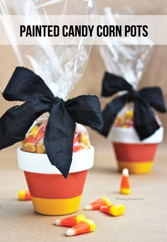 Fabulous and Easy Painted Candy Corn Pots. Great for treat giving. Tutorial at livelaughrow.com #candycorn