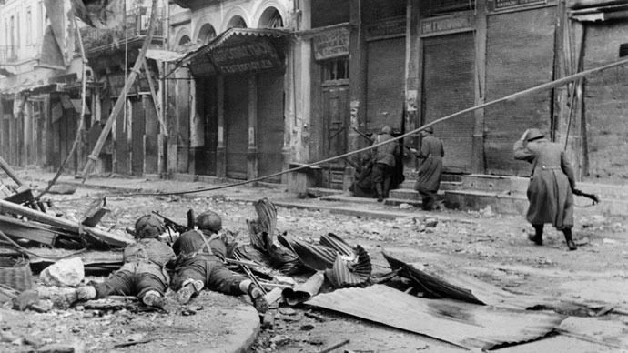 Battle of Athens, Dec 44-Jan 45. Greek gendarmes (right) advance as British BREN light machine gun element provides cover. Vicious fighting with the communist insurgents destroyed large parts of the city.