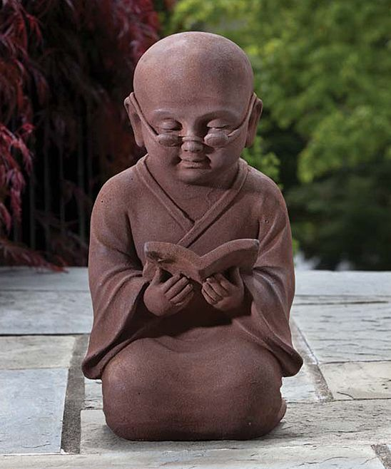 Alfresco Home Reading Buddha Garden Statue   Add a unique touch of décor to the garden with this Buddha statue. Crafted from durable polyresin and stone, this whimsical piece will provide the perfect flourish to any outdoor area!
