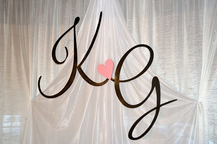 Laser cut out monogram which we painted and suspended with fishing line.