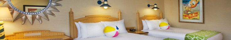Spwnd one night at a DIsneyland hotel and do 2 days in the parks A queen bed with a beach ball-style pillow, writing desk and, beyond, an easy chair and a window