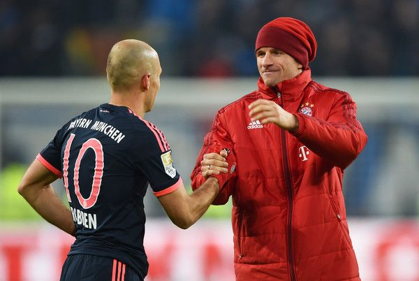 Thomas Mueller (R) and Arjen Robben of Bayern Munich celebrate victory after the Bundesliga match between Hamburger SV and FC Bayern Muenchen at Volksparkstadion on January 22, 2016 in Hamburg, Germany.