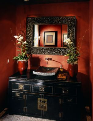 Interesting sink.  Love the cabinet, wall color, pebbled mirror and orchids!  Oh, MM......