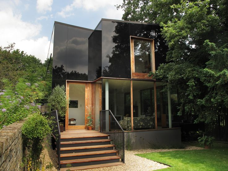 Tree House, Sydenham - Ian McChesney Architects.  I like the opaque glass panels that reflect the building's context!