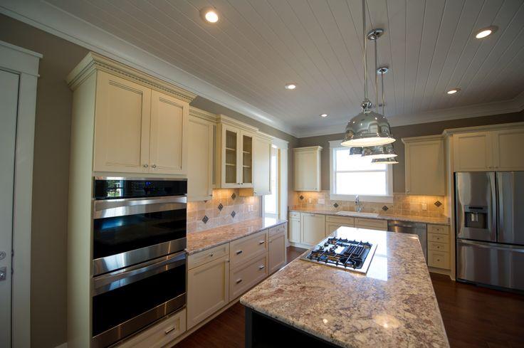 Maple Cabinets Stone Backsplash And Granite Countertops