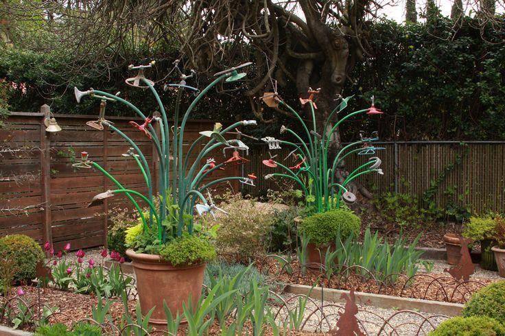 Yard art...rebar, garden hose and vintage sprinklers by Freeland + Sabrina Tanner