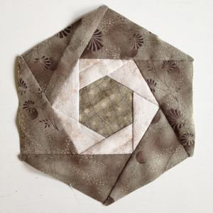Found this hexagon quilt block in an older Japanese Patchwork Tsushin magazine. Would love to make an entire quilt with it.