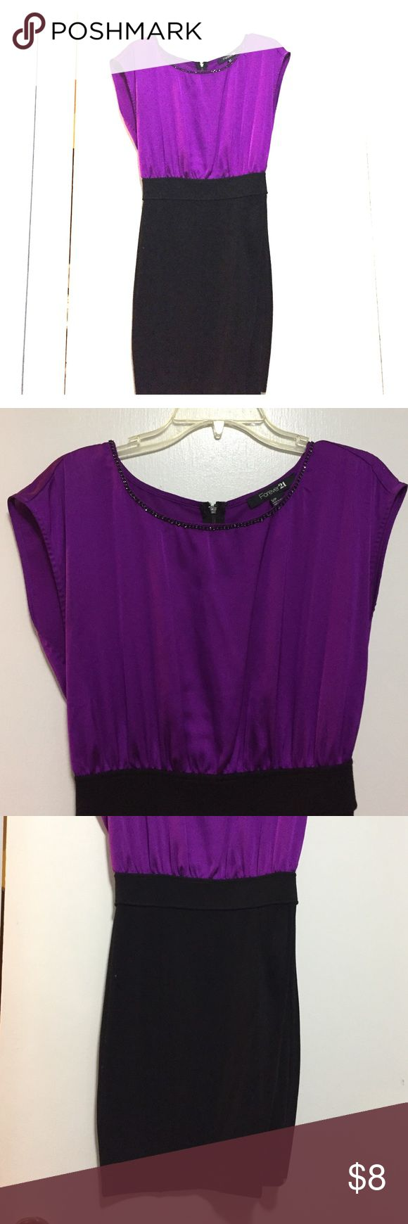 Forever21 Night out dress Purple and black dress perfect for girls night out or date night! Black tight fitted skirt, top is flown and bright. Forever 21 Dresses Mini