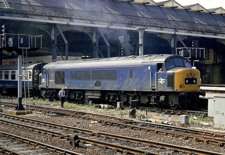 46037 departs Manchester Victoria on a Trans-Pennine service on 06-08-1983. Although not rare on these services in the early 1980's the 46's were less common than the 45's.