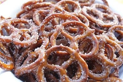 Smell so good when baking! Cinnamon Sugar Pretzels: 1 (16 oz) bag pretzel twists, 1/2 cup veg oil, 1/2 cup sugar, 2 tsp cinnamon. Preheat oven to 300. Pour pretzels into a roasting pan. Mix together oil, cinnamon and sugar. Pour on pretzels, stir to coat. Bake 30 mins, stirring twice during baking time.