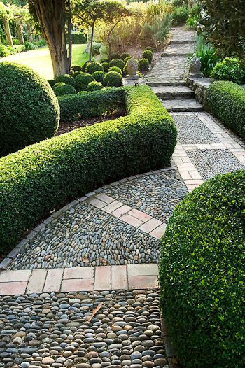 mixture of stone/pebble brick paths w/ flagstone steps edged in boxwood hedge topiary accents -- Designer Dominique La fourcade, one of Provences best-known Country Garden Designers -- Clive Nichols garden photography