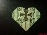 Tutorial for folding money into a heart, I did this for a wedding gift.  :)