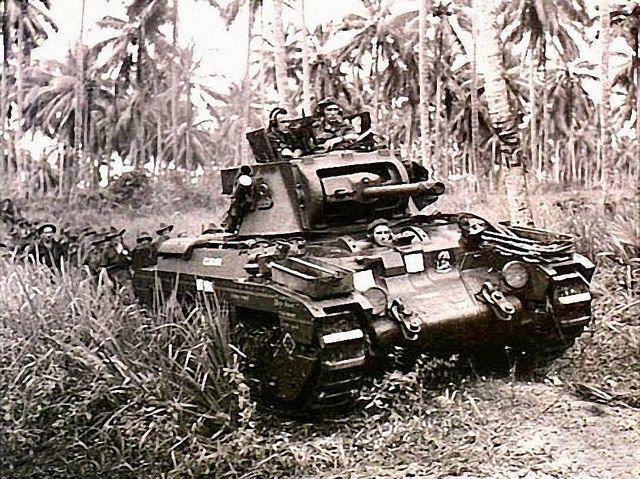 """A Matilda tank, named """"Clincher"""", moves towards Japanese strong points near Finschhafen, on 9 November 1943..."""