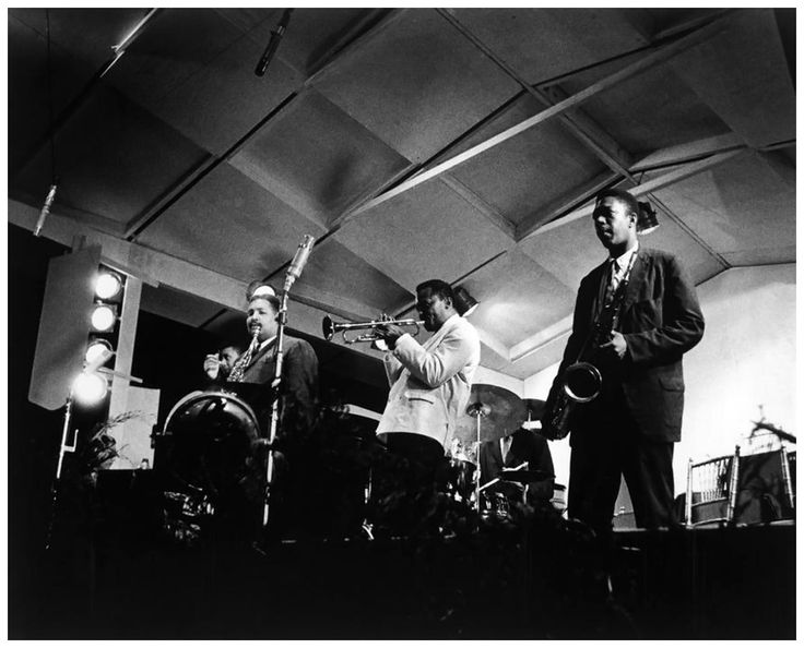 "From left to right : Julian Edwin ""Cannonball"" ADDERLEY (alto saxophone ), Paul Chambers (double bass), Miles Davis (trumpet) and John Coltrane (tenor saxophone). Description from jazzinphoto.wordpress.com. I searched for this on bing.com/images"