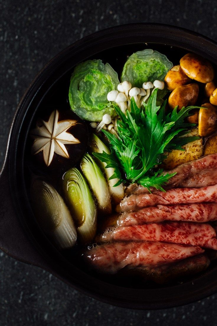A comforting Japanese beef sukiyaki recipe from Hideki Hiwatashi featuring mixed…