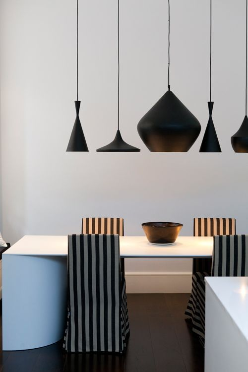 A London Triplex. Here's another property recently remodelled by Studio CH, Caradoc-Hodgkins Architecture www.sch-architects.com The black and white colour scheme with dark wood floors is dramatic and modern.  The main attraction? The to-die-for grouping of Tom Dixon Beat lights over the dining table.