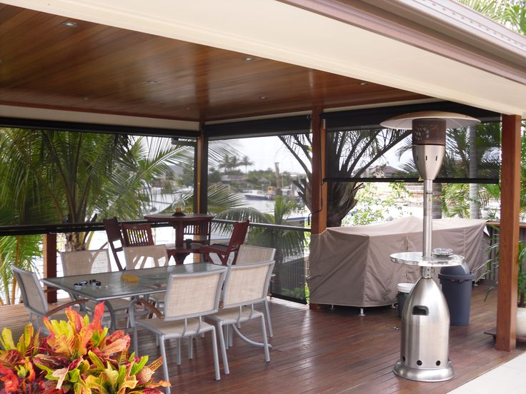 This is a Gearbox Operated blind, you use a crank handle to operate the movement of the blind. As you can see in this view these blinds do not take away from the view and when rolled away do not impede on the opening. These beautiful blinds calm the view and enhance the ambiance of your outdoor lifestyle Call us 1300 799 944  for a free measure and quote.