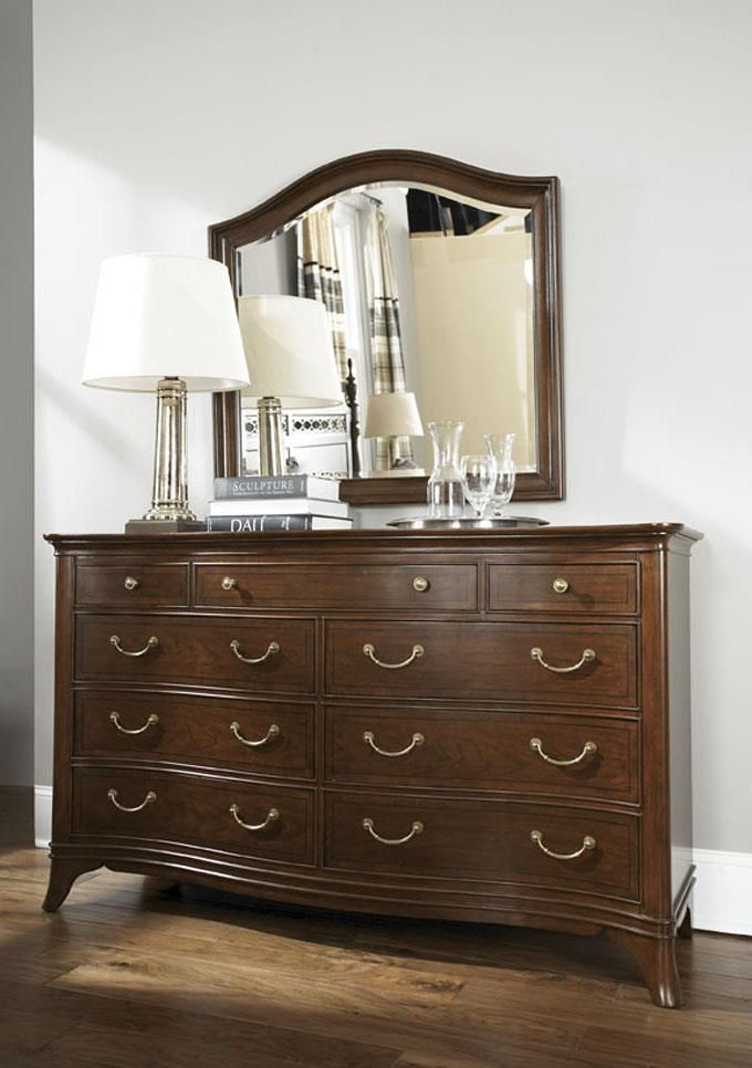 Photo of Cherry Grove Arched Landscape Mirror And Triple Dresser In Mid Tone Brown