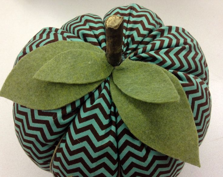 ridiculously easy and cute fabric pumpkin DIY I use cinnamon sticks for the stem with a bow instead of leaves.  Cute!