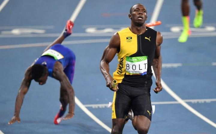 USA'S Trayvon Bromell stumbling in the wake of Usain Bolt at finish of 4 x 100m Relay Final