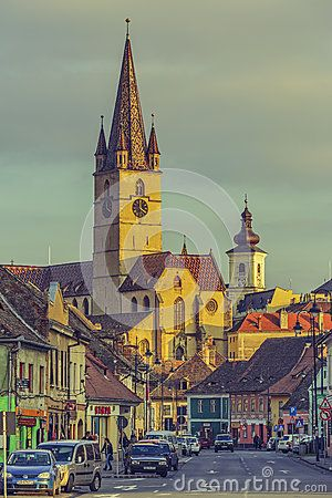 Sibiu, Romania - 12 November, 2015: The Lutheran Cathedral of Saint Mary in the sunset light. Built in the 14th century, with a 73.34 m high steeple, it is the landmark of Sibiu city in Transylvania.