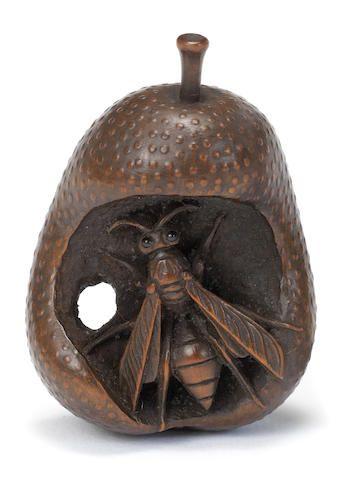 A wood netsuke of a wasp in pear By Kogetsu, Edo period (1615-1868), 19th century