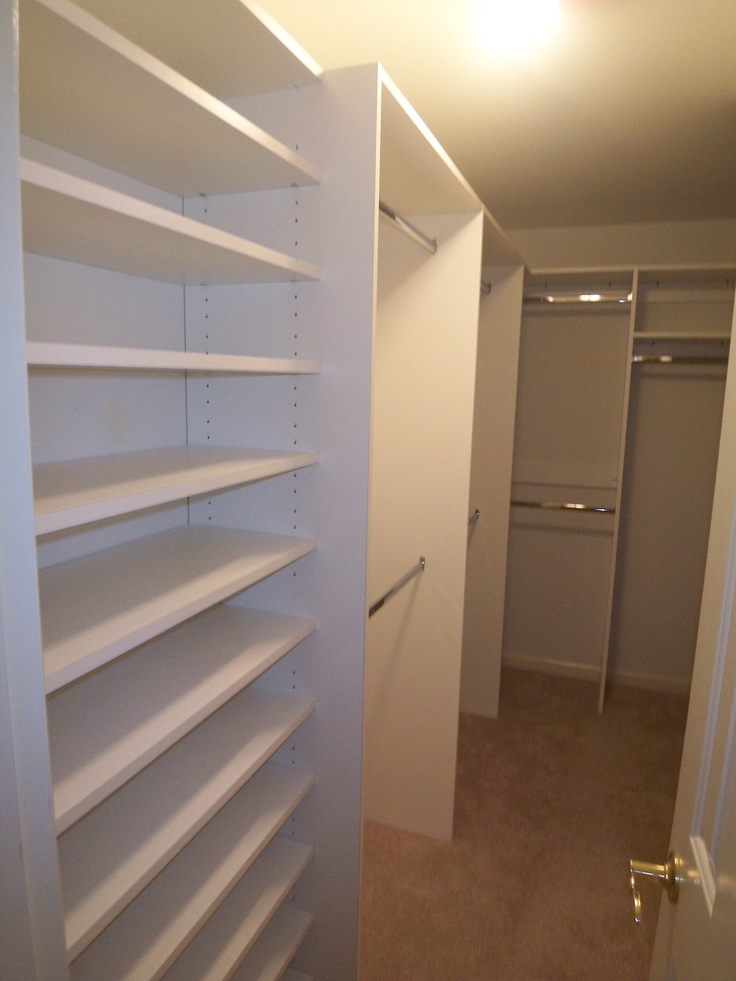 A narrow walk in closet with a door that opens in can for Doors for walk in closet