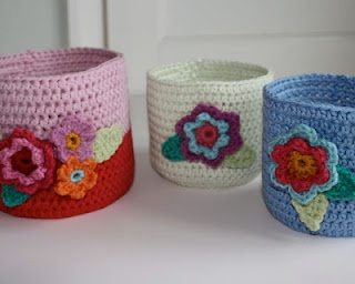 Crochet baskets could double as toilet tissue covers.