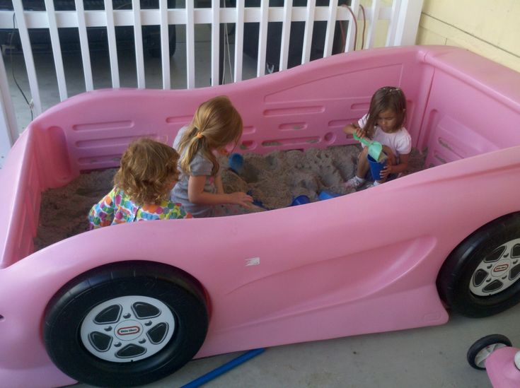Repurposed a Little Tikes Twin bed into a racecar sandbox for the girls!