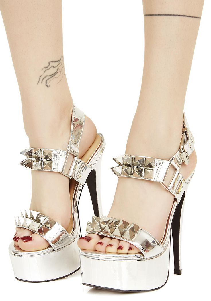 Current Mood Queen Pin Studded Heels yew know how to play the game better than anyone else, babe. Let 'em know with these deadly heels that feature a shiny silver construction, skinny stiletto heel, adjustable ankle strap, and two straps with sharp N' spiky studs goin' across yer foot.