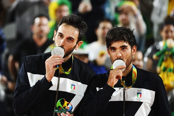 Silver medalists Paolo Nicolai and Daniele Lupo of Italy pose on the podium during the medal ceremony for the Men's Beachvolleyball contest at the Beach Volleyball Arena on Day 13 of the 2016 Rio Olympic Games on August 18, 2016 in Rio de Janeiro, Brazil.