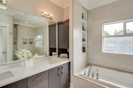 Dark wood accents this all white bathroom to give it a clean, simple style!