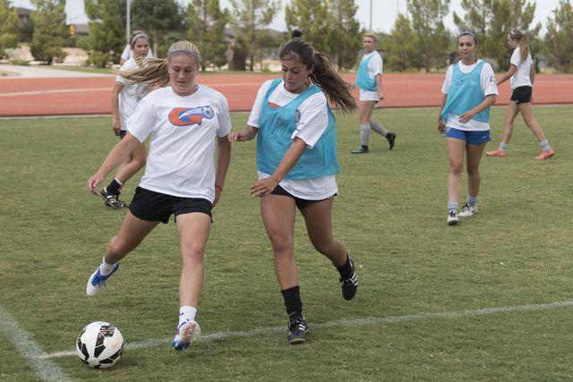 Arlie Jones (51), left, kicks the ball during girls soccer practice at Bishop Gorman High School in Las Vegas Thursday, Aug. 18, 2016. Jason Ogulnik/Las Vegas Review-Journal