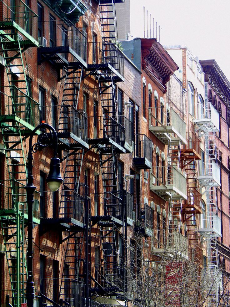 "wanderingnewyork: "" Fire escapes and a street light on the Lower East Side. """