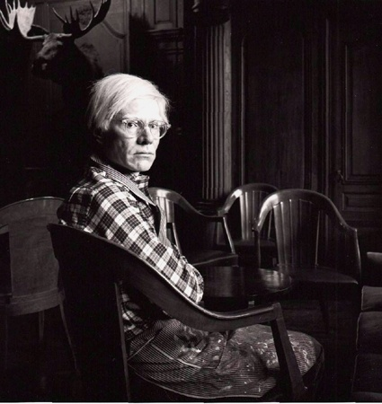 Title:    Andy Warhol  Caption:    Portrait of Andy Warhol at the infamous 'Factory'. This is where his workers would make silkscreens and lithographs, as well as being a hangout for artsy types.    Artist:    Michael Tighe  Date:    1975, New  Medium:    Silver Gelatin Fiber Print  Copyright:    © Michael Tighe  Comments:    Warhol in the dining room at �The Factory�