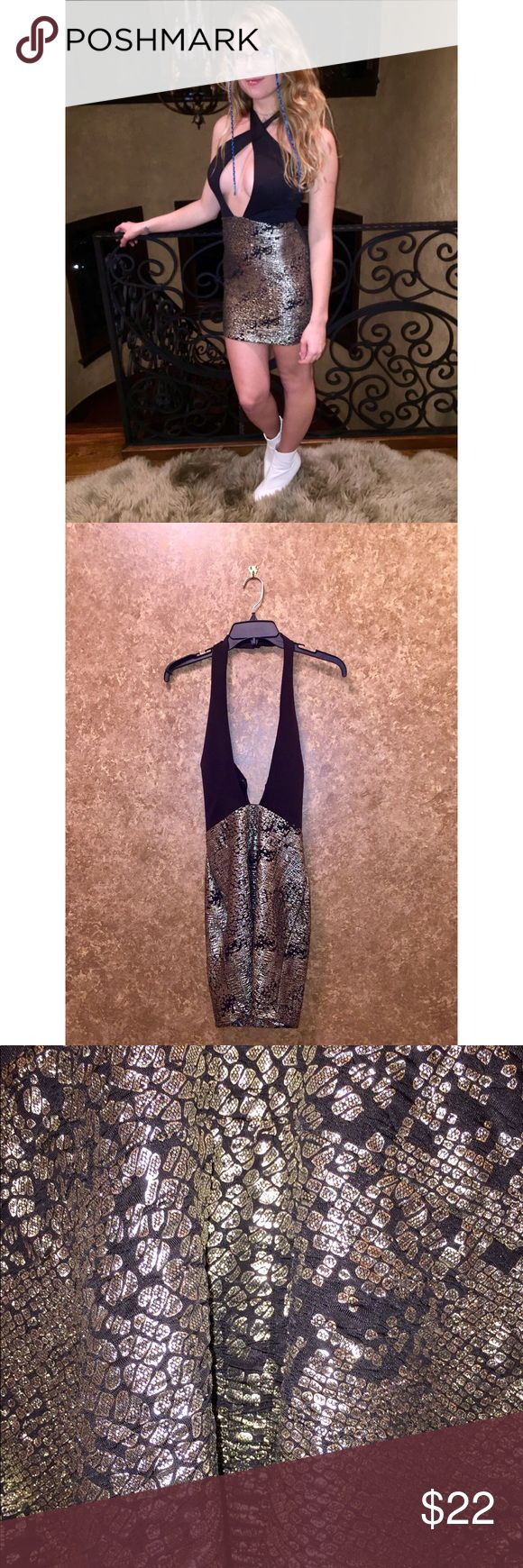 Sexy Low Cut V Neck Metallic Gold Dress Sexy dress for a night out!  Has a very unique cut out in the front! Windsor Dresses Mini