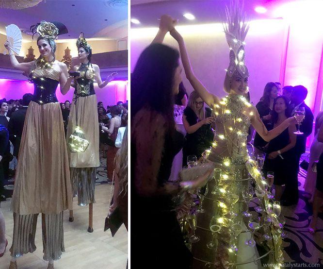 Golden Stilt Walkers & Light Up Champagne Skirt for Hack Cancer Event by Catalyst Arts