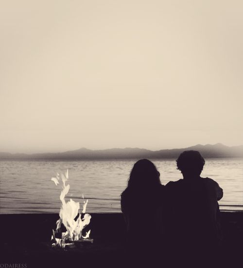 Sitting by the fire love beach outdoors couple mountains animated gif