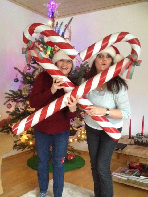 Giant candy canes. Made with large cardboard tubes taken from material bolts, foam pipe lagging pushed inside tubes. Taped up with red and white stripe builders type tape. The bend is held with wire.