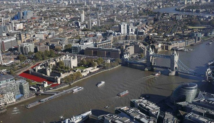 """General view of art installation """"Blood Swept Lands and Seas of Red"""" at the Tower of London and the Tower Bridge spanning the Thames in London   The Tower of London poppies memorial is nearly finished and it looks spectacular - Yahoo News UK"""