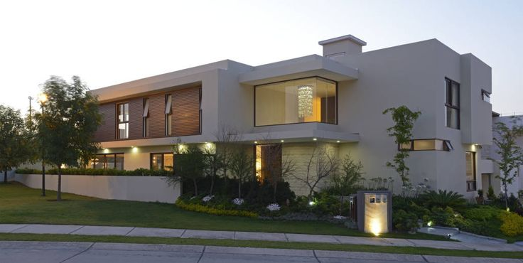 Fachada Principal Casa GL (De VICTORIA PLASENCIA INTERIORISMO)