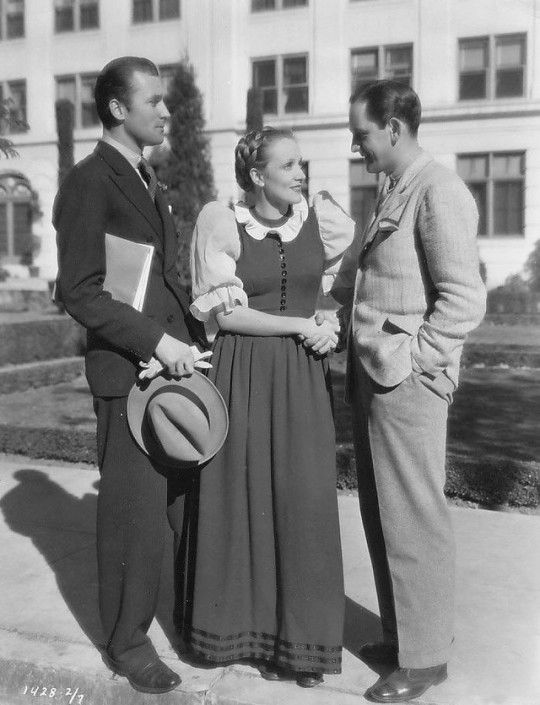 Fredric March visits Marlene Dietrich and Brian Aherne on the set of The Song of Songs, 1933