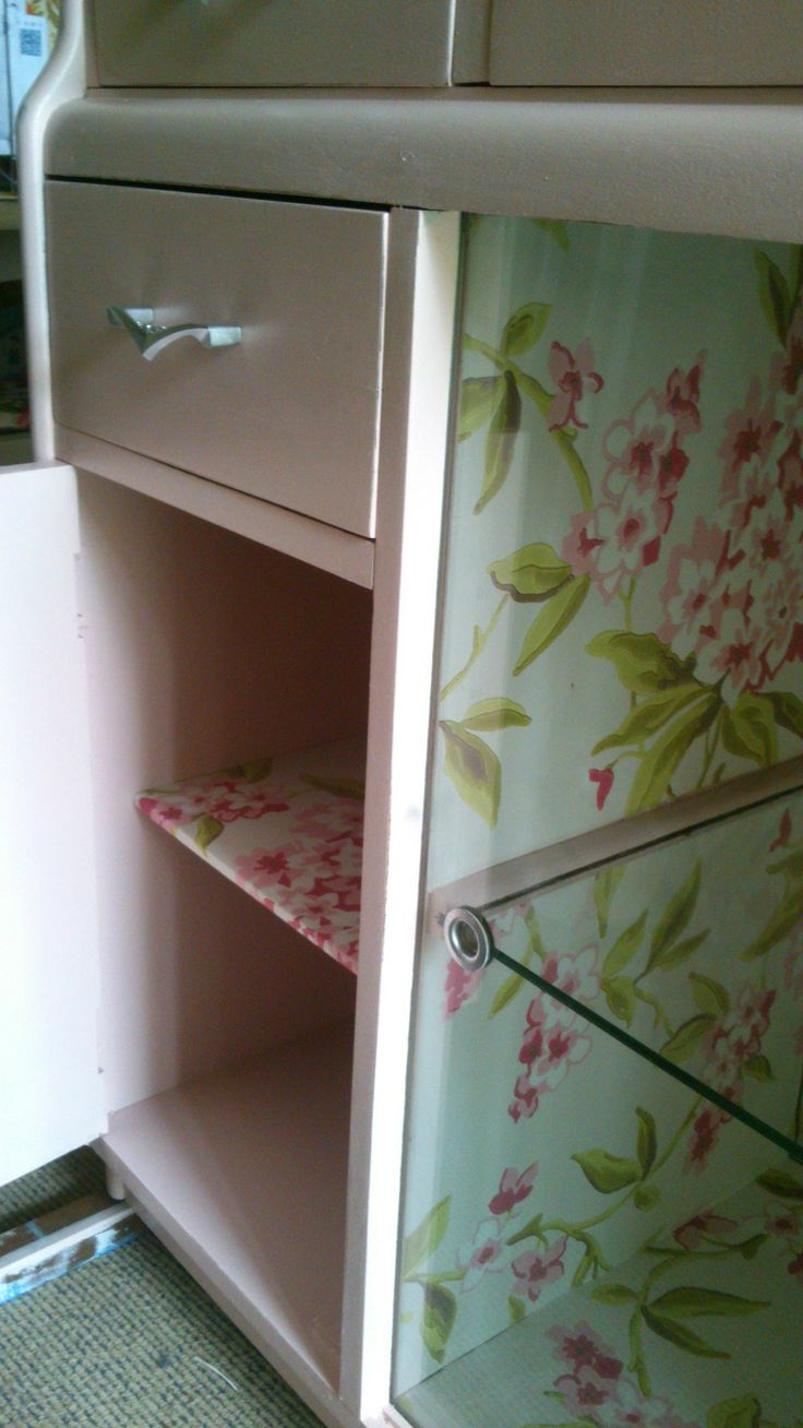 Inside of cabinet - painted inside and left over wallpaper used on the shelves and inside of display