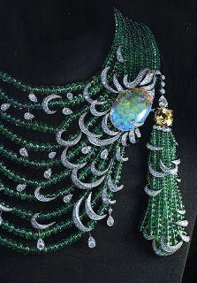Cartier :              Yellow sapphire necklace 11 carats  14 cushion, 1 opal 26.04 carats, 1 yellow diamond pear balls of emeralds and brilliant-cut diamond,