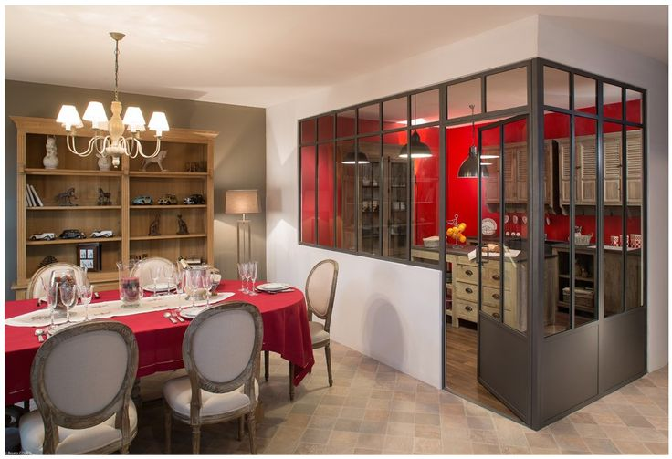 A very unusual way of incorporating an open-plan kitchen into a living-dining space. Easily made more more traditional or contemporary in style or keep as it is with its warm, handsome look. Genial reds and browns give a very mellow feel to the whole area.