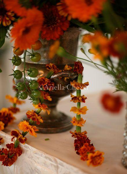 Ariella Chezar, photos by Emma Dodge Hanson. Strands of marigolds for an Indian wedding
