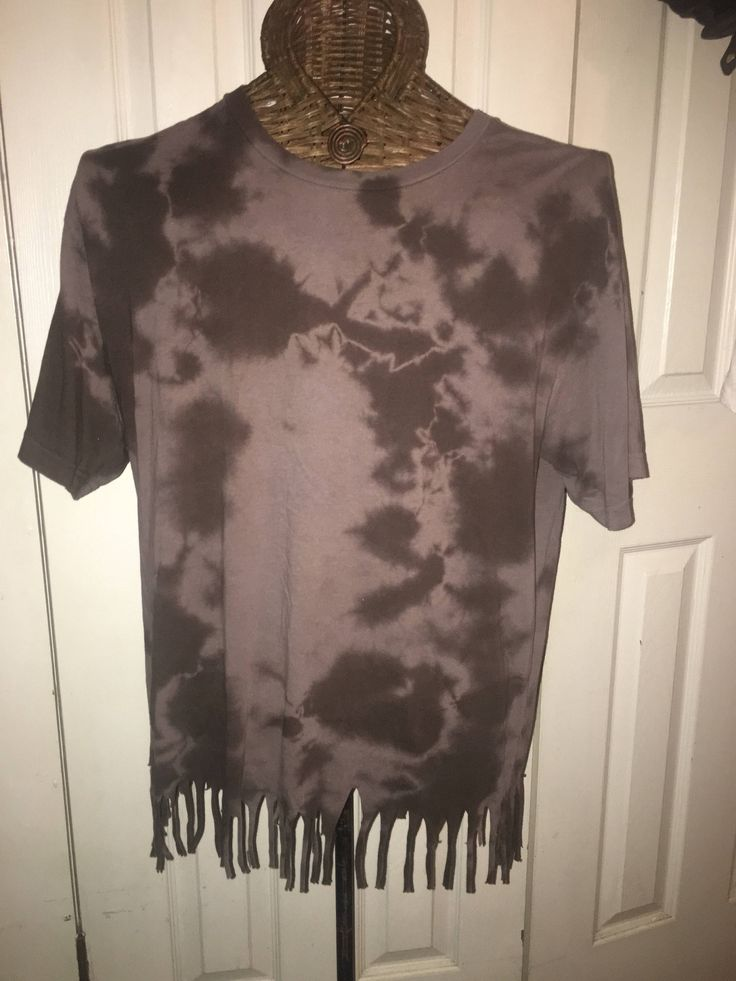 A personal favorite from my Etsy shop https://www.etsy.com/listing/528269996/bleached-tie-dyed-fringe-t-shirt