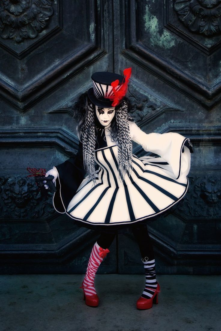 Carnival model in black, white and red in front of a church door
