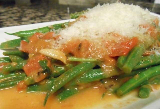 Fresh haricot verts sauteed with heirloom tomatoes, shaved garlic and ...