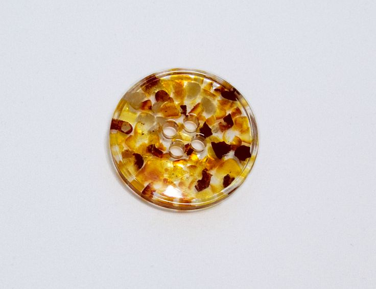 Handmade button made of crystalline resin with addition of baltic amber are light and durable. Natural material reveals dignity of any plain dress